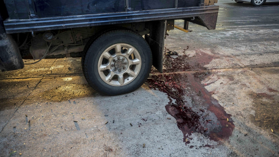 Blood stains the street after a gunfight in Culiacan, Mexico, on Oct. 17, 2019. (Augusto Zurita / AP)