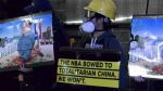 Pro-Hong Kong protesters gathered outside Rogers Arena ahead of Thursday night's preseason NBA game.