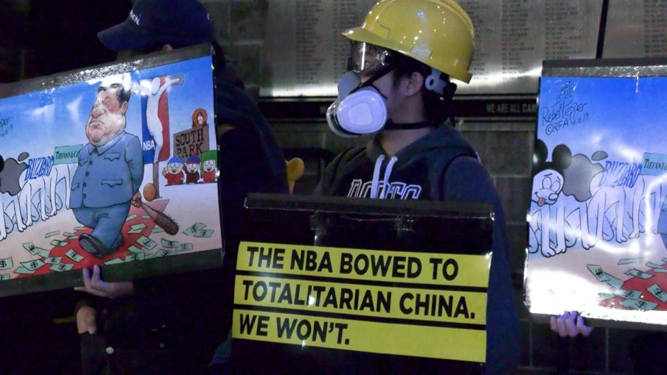 Pro-Hong Kong protesters gathered outside Rogers Arena ahead of Thursday night's preseason NBA game.