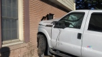 Truck smashes through wall of house after crash