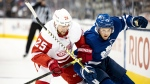 Toronto Maple Leafs centre Alexander Kerfoot (15) is defended by Detroit Red Wings defenceman Mike Green during first period NHL pre-season hockey action in Toronto, Saturday, Sept. 28, 2019. THE CANADIAN PRESS/Christopher Katsarov