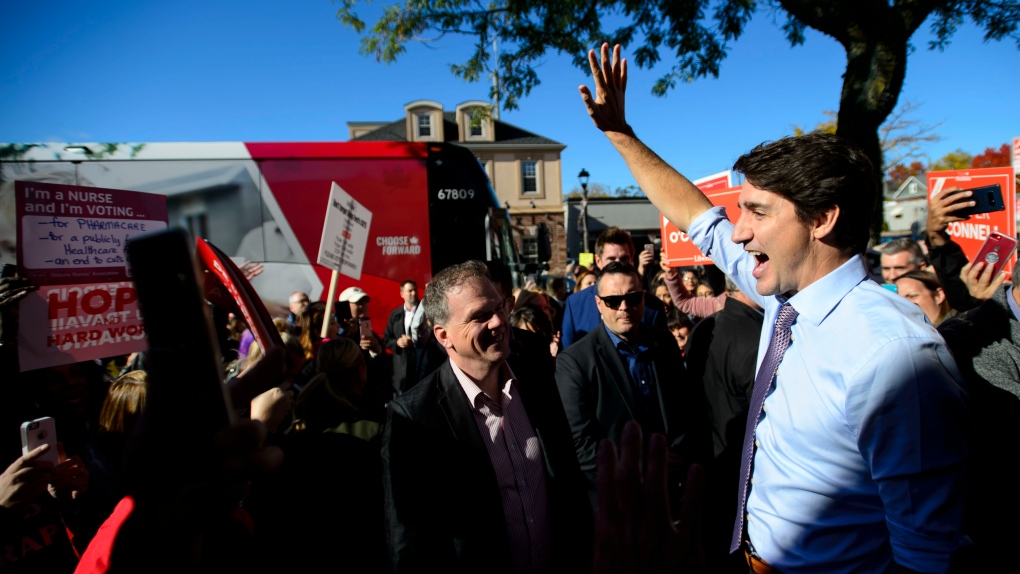 Trudeau maintains it's a two-party race while Scheer raises fears over 'Liberal-NDP' coalition