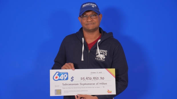 Subramaniam Jeyakumaran claimed his winnings from the Oct. 9 draw at the lottery prize centre in Toronto on Friday.(Handout/Ontario Lottery and Gaming Corporation)