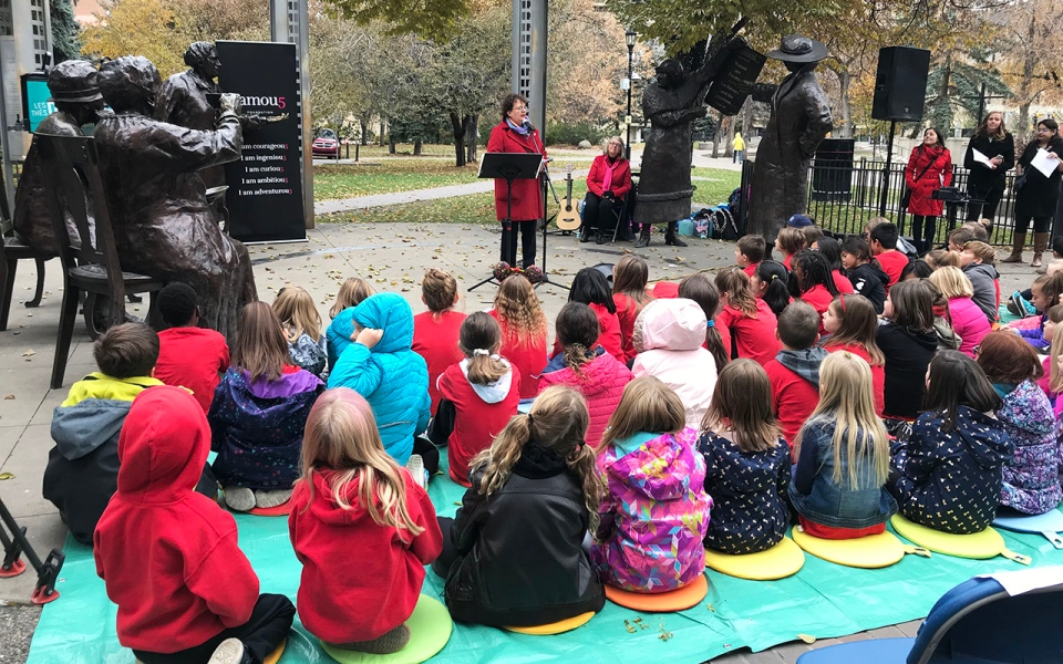 Senator Paula Simons addresses all ages crow at Famous Five monument at Olympic Plaza