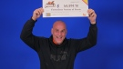 A Barrie bar owner holds up the big cheque from OLG after winning with POOLS. (Fri., Oct. 18, 2019 - Supplied)
