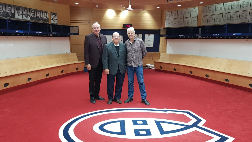 Ken Dryden, left, Scotty Bowman, centre, and W5 producer Steve Grant, right, can be seen in the Montreal Canadiens' dressing room in the Bell Centre.