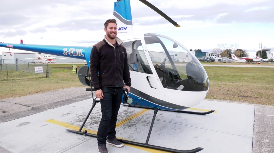 Olympic silver medalist Tristan Walker poses with a helicopter. The now 28-year-old says he plans on becoming a pilot after the 2022 Winter Games in Beijing.
