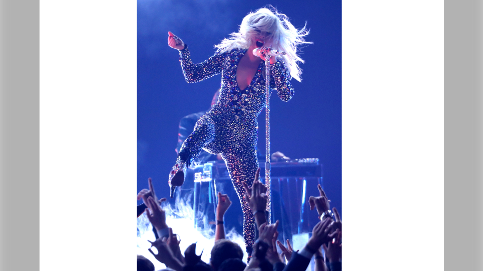 This Feb. 10, 2019 file photo shows Lady Gaga performing at the Grammy Awards in Los Angeles. Lady Gaga is recovering after falling off stage while dancing with a fan at a concert. During her Las Vegas show Thursday night, the pop star invited a fan onstage who picked her up and lost balance, and both plunged to the floor as a result. (Photo by Matt Sayles/Invision/AP, File)