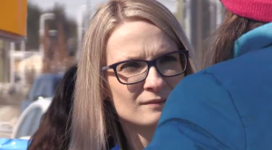 Amy Fee seen here at speaking to a protestor at a demonstration outside her office in March.