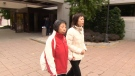 Jenny Wu, on the right, leaves Ottawa court on Friday, Oct. 18, 2019 feeling that a 2 ½ year sentence for the man who claimed the life of her husband came nowhere close to the justice she was seeking.