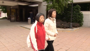 Jenny Wu, on the right, leaves Ottawa court.
