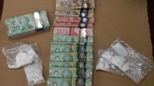 Cocaine and cash seized at a home in London, Ont. on Thursday, Oct. 17, 2019 is seen in this image released by the London Police Service.
