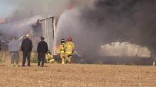 Emergency crews work at the scene of a barn fire near Wingham, Ont. on Friday, Oct. 18, 2019. (Scott Miller / CTV London)