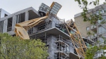 A toppled building crane is draped over a new construction project in Halifax on Sunday, Sept. 8, 2019. A proposed class action lawsuit is looking to recover losses sustained by businesses and residential tenants displaced by the collapse of a construction crane in downtown Halifax last month during post tropical storm Dorian. (THE CANADIAN PRESS/Andrew Vaughan)