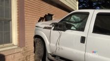 Truck smashes into side of house after crash