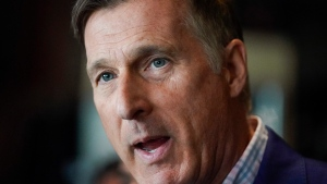 People's Party of Canada leader Maxime Bernier speaks at a news conference at the 3 Brasseurs restaurant in Quebec City on Friday, October 18, 2019. (THE CANADIAN PRESS / Mathieu Belanger)