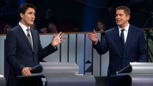 Liberal leader Justin Trudeau and Conservative leader Andrew Scheer take part in the the Federal leaders French language debate in Gatineau, Que. on Thursday, October 10, 2019. THE CANADIAN PRESS/Adrian Wyld
