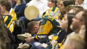 In this file photo, family members and friends look on during the Humboldt Broncos memorial service at Elgar Petersen Arena in Humboldt, Saskatchewan on Saturday, April, 6, 2019. THE CANADIAN PRESS/POOL-Liam Richards