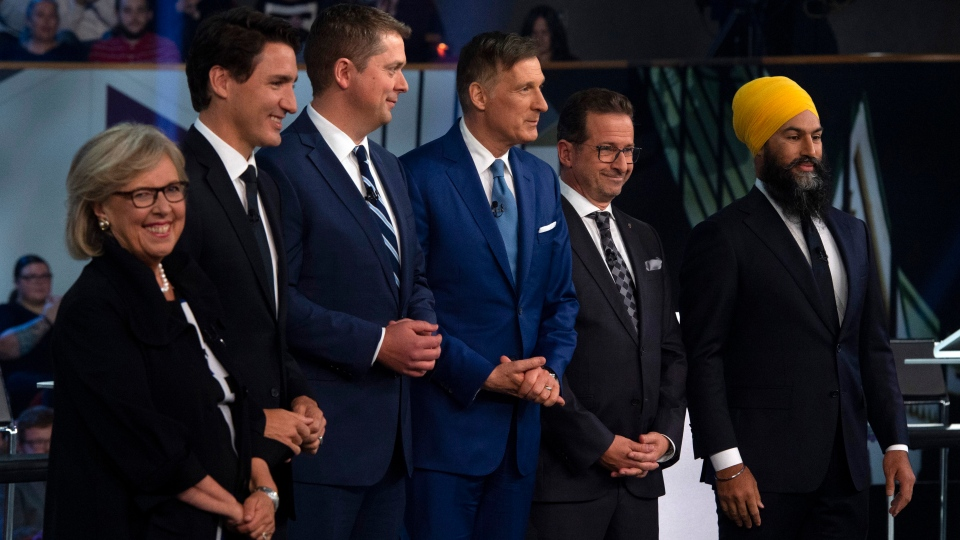 Green Party Leader Elizabeth May, Liberal Leader Justin Trudeau, Conservative Leader Andrew Scheer, People's Party of Canada Leader Maxime Bernier, Bloc Quebecois Leader Yves-Francois Blanchet and NDP Leader Jagmeet Singh pose for a photograph before the English-language federal leaders' debate in Gatineau, Que. on Monday, October 7, 2019. (THE CANADIAN PRESS / Sean Kilpatrick)