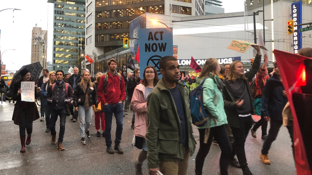 Vancouver climate protests create spectacle during Black Friday rush
