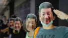 Protesters wear masks of Chinese President Xi Jinping in Hong Kong, Friday, Oct. 18, 2019. Hong Kong pro-democracy protesters are donning cartoon/superheroes masks as they formed a human chain across the semiautonomous Chinese city, in defiance of a government ban on face coverings. (AP Photo/Kin Cheung)
