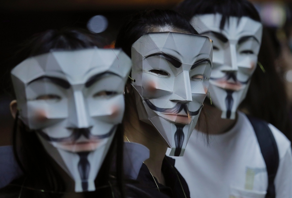 Protesters wear masks in Hong Kong, Friday, Oct. 18, 2019. (AP Photo/Kin Cheung)
