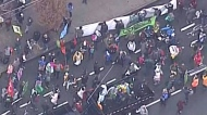 Climate protesters disrupt rush hour traffic