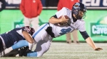 Toronto Argonauts quarterback McLeod Bethel-Thompson (4) is brought down by Montreal Alouettes' Ryan Brown during first half CFL football action in Montreal on Friday, October 18, 2019. THE CANADIAN PRESS/Graham Hughes