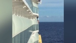A woman was removed from a cruise ship and banned for life by the cruise company after she climbed onto her room's balcony railing to pose for a dangerous photo shoot over the ocean. (CNN via Courtesy Peter Blosic)