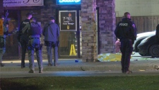 Police are seen outside a bar on York Blvd. in Hamilton on Oct. 19 where a male was shot to death. (Dave Ritchie)