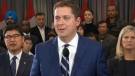 Scheer takes questions from reporters