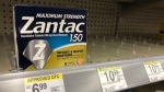 In this Sept. 30, 2019, file photo a box of Maximum Strength Zantac tablets is shown at a pharmacy in Miami Beach, Fla. Walmart has become the latest store to halt sales of the popular heartburn treatment Zantac after health regulators warned about a potentially dangerous contaminant in the drug. (AP Photo/Wilfredo Lee, File)