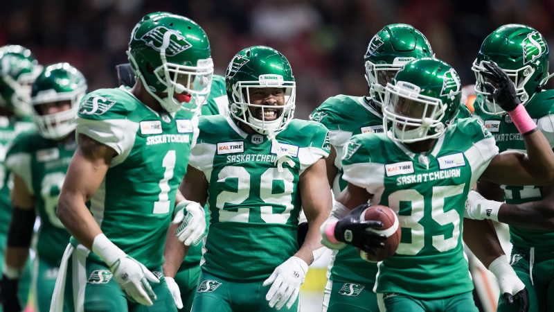 Saskatchewan Roughriders' William Powell (29), Shaq Evans (1) and Kyran Moore (85) celebrate Powell's touchdown against the B.C. Lions during the first half of a CFL football game in Vancouver, on Friday October 18, 2019. THE CANADIAN PRESS/Darryl Dyck