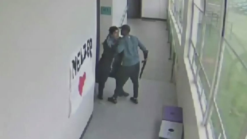 Video captures moment coach hugs student after disarming him of a shotgun