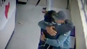 Coach who disarmed student hailed as hero