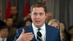Conservative leader Andrew Scheer responds to questiones from the media during a campaign stop in Toronto, Que. Saturday October 19, 2019. (THE CANADIAN PRESS/Adrian Wyld)