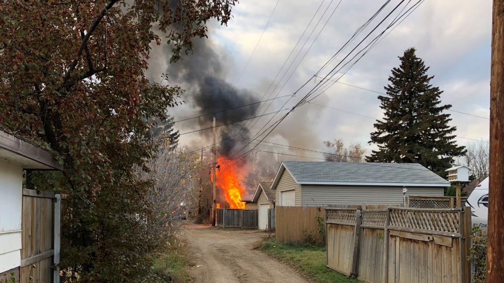 Early morning blaze engulfs garage, affects power lines