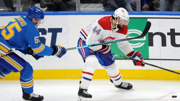 St. Louis Blues' Colton Parayko (55) reaches for the puck with Montreal Canadiens' Nate Thompson (44) during the second period of an NHL hockey game, Saturday, Oct. 19, 2019, in St. Louis. (AP Photo/Bill Boyce)
