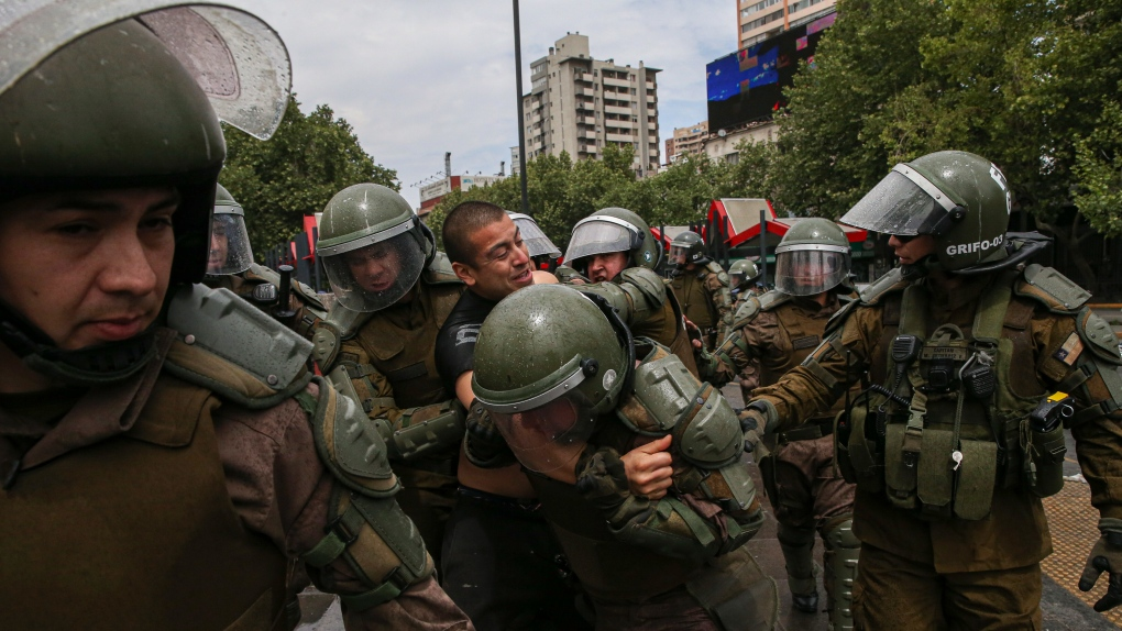 Soldiers patrol Chilean capital after violent protests