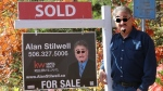 After someone vandalized New Brunswick real estate agent Alan Stilwell's sign, he delighted the internet by posting a photo of him posing next to the sign -- with the same squiggled features drawn on his own face. (Alan Stilwell)