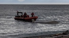 Rescue crews responded to a capsized boat off Clover Point on Saturday afternoon.