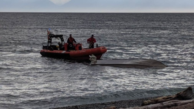 Boat capsized near Victoria