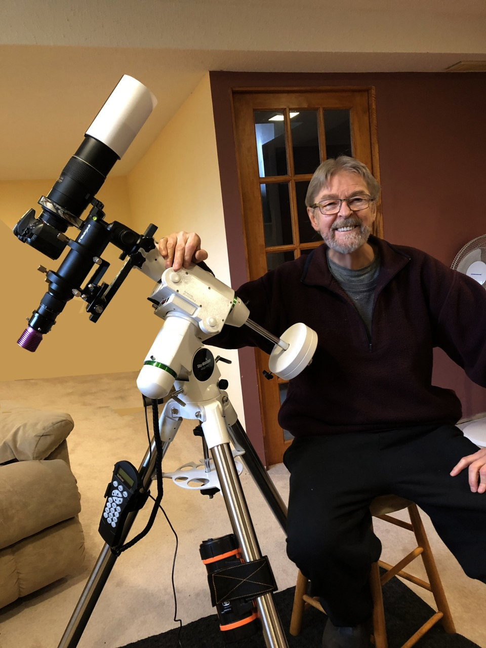 Rudy Pohl used to use his own equipment to photograph the stars, but had to sell his cameras and telescopes when chronic illness made it impossible for him to continue. In this photo, he poses with his Sky-Watcher HEQ5 Pro equatorial mount. (Rudy Kohl)