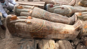 This Tuesday, Oct. 15, 2019 file photo provided by the Egyptian Ministry of Antiquities shows recently discovered ancient colored coffins with inscriptions and paintings, in the southern city of Luxor, Egypt. (Egyptian Ministry of Antiquities via AP)