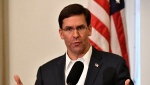 In this Friday, Oct. 4, 2019 file photo, Defense Secretary Mark Esper speaks to a gathering of soldiers at the University Club at the University of Louisville in Louisville, Ky.  (AP Photo/Timothy D. Easley, File)