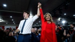 Liberal Leader Justin Trudeau hoists the hand of Liberal candidate Nirmala Naidoo as he attends a rally in Calgary, Saturday, Oct. 19, 2019. (THE CANADIAN PRESS/Sean Kilpatrick)