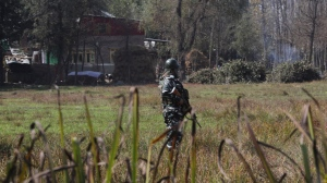 An Indian paramilitary soldier stands guard near the site of a gunbattle in Bijbehara, south of Srinagar, Indian controlled Kashmir, Wednesday, Oct. 16, 2019.  (AP Photo/Mukhtar Khan)