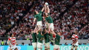 South Africa's Franco Mostert, left, and RG Snyman, right, are lifted to win a ball in a lineout during the Rugby World Cup quarterfinal match at Tokyo Stadium in Tokyo, Japan, Sunday, Oct. 20, 2019. (AP Photo/Eugene Hoshiko)