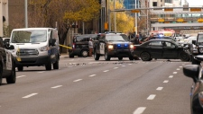 Two people were arrested on Saturday after they tried to drive a vehicle towards a military parade in downtown Calgary.