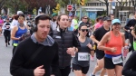 People run along University Avenue in downtown Toronto to take part in the Scotiabank Toronto Waterfront Marathon on Sunday, Oct. 20, 2019. (Ted Brooks/CTV News Toronto)